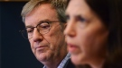 Ottawa Mayor Jim Watson looks on as Dr. Vera Etches, Medical Officer of Health, Ottawa Public Health provides an update on the first confirmed case of novel coronavirus (COVID-19) in Ottawa on Wednesday, March 11, 2020. (Sean Kilpatrick/THE CANADIAN PRESS)