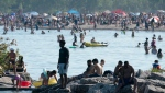 Thousands of people spend time on the beach by Lake Ontario in Toronto on Saturday June 20, 2020. THE CANADIAN PRESS/Frank Gunn