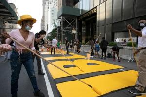 New York began painting a Black Lives Matter mural outside Trump Tower on midtown Manhattan's Fifth Avenue. (Mark Lennihan/AP)
