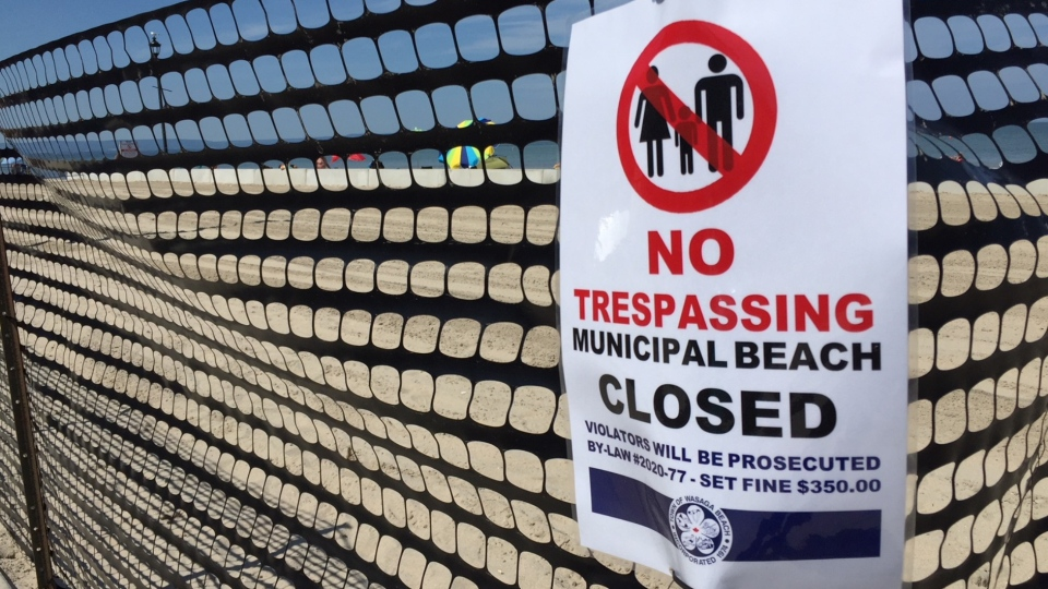 The town of Wasaga Beach has put up a snow fence to keep the public off a section of the beach. July 9, 2020. (Roger Klein/CTV News)