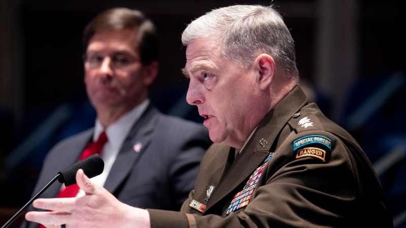 Defense Secretary Mark Esper, left, listens as Chairman of the Joint Chiefs of Staff Gen. Mark Milley testifies during a House Armed Services Committee hearing on Thursday, July 9, 2020, on Capitol Hill in Washington. (Michael Reynolds/Pool via AP)