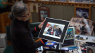 Eileen Miskolczi looks at pictures of her late son, Jamie. (Laura Woodward/CTV Saskatoon)