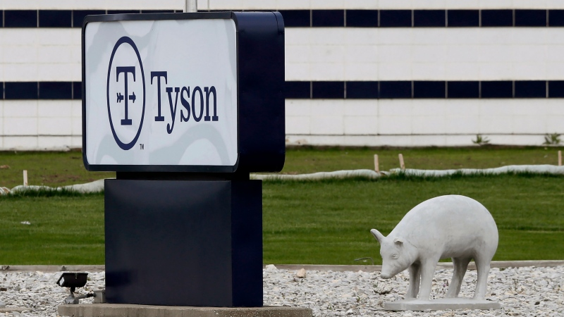 In this May 1, 2020, file photo, a sign sits in front of the Tyson Foods plant in Waterloo, Iowa. A group of worker advocacy organizations has filed a civil rights complaint with the U.S. Department of Agriculture alleging that meat processing companies Tyson and JBS have engaged in workplace racial discrimination during the coronavirus pandemic. The complaint alleges the companies adopted polices that reject U.S. Centers for Disease Control and Prevention guidance on distancing and protective gear on meat processing lines. The complaint says the operating procedures have a discriminatory impact on mostly Black, Latino, and Asian workers. (AP Photo/Charlie Neibergall, file)