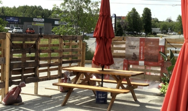 Two picnic tables and two umbrella bases were stolen from the Stack Brewhouse property on Falconbridge road Monday night. (Molly Frommer/CTV News)