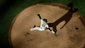 Milwaukee Brewers' Freddy Peralta throws during a practice session Monday, July 6, 2020, at Miller Park in Milwaukee. (AP Photo/Morry Gash)