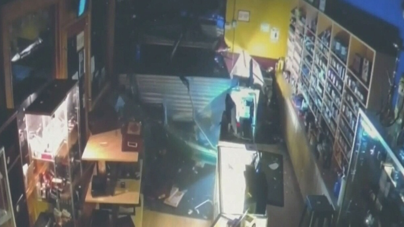 Robbers crash vehicle into shop