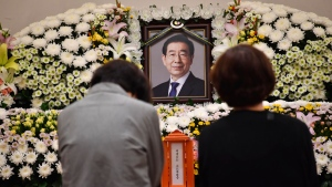 In this photo provided by Seoul Metropolitan Government, a portrait of the deceased Seoul Mayor Park Won-soon is placed at a hospital in Seoul, South Korea, Friday, July 10, 2020. (Seoul Metropolitan Government via AP)