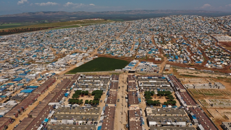 In this April 19, 2020 photo file photo, shows a large refugee camp on the Syrian side of the border with Turkey, near the town of Atma, in Idlib province, Syria. (AP Photo/Ghaith Alsayed, File)