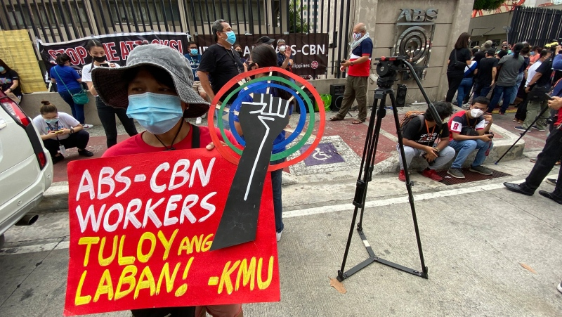 Supporters calling for the franchise renewal of ABS-CBN wait outside the ABS-CBN compound in Quezon City, Philippines Friday, July 10, 2020. (AP Photo/Aaron Favila)