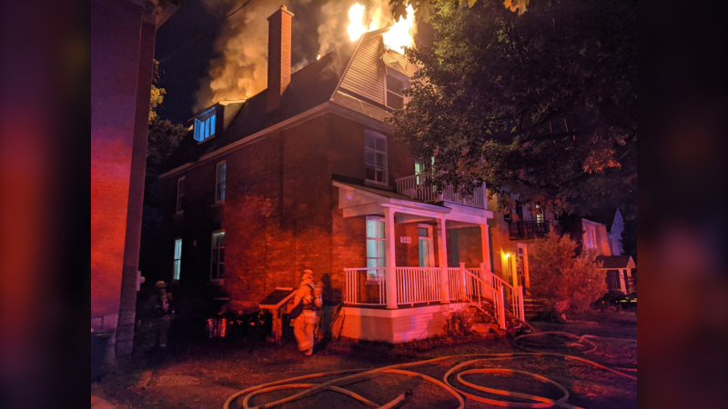 Ottawa firefighters battled a blaze in a home on Chapel Street in Sandy Hill overnight. (Photo courtesy: Twitter/OFSFirePhoto)