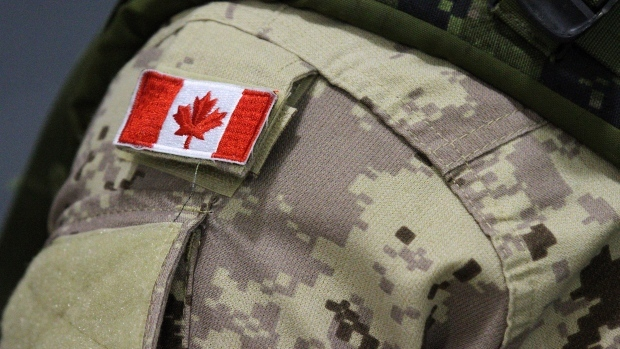 A Canadian flag patch is shown on the shoulder of a member of the Canadian forces at CFB Trenton, in Trenton, Ont., on Thursday, Oct. 16, 2014. (THE CANADIAN PRESS/Lars Hagberg)