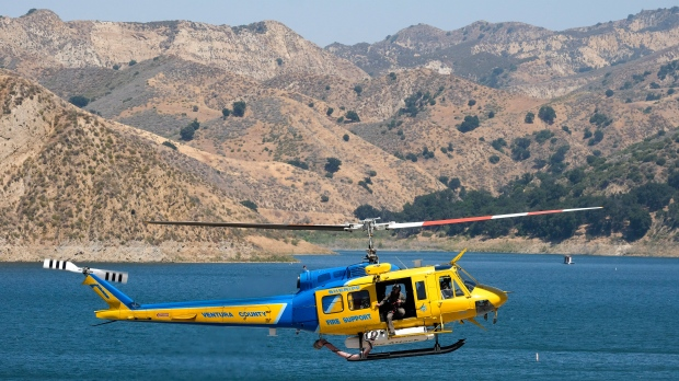 """A Ventura County sheriff's helicopter helps in the search for former """"Glee"""" actress Naya Rivera, Thursday, July 9, 2020, at Lake Piru in Los Padres National Forest, northwest of Los Angeles. (AP Photo/Ringo H.W. Chiu)"""