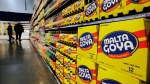 People walk past displays of Goya Foods products at the corporate headquarters in Jersey City, N.J., on April 29, 2015. (Mel Evans / AP)