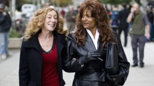 Dominatrix Terri-Jean Bedford, right, carries a riding crop while walking with sex workers advocate Valerie Scott in front of Ontario Superior Court in Toronto on Tuesday, Oct. 6, 2009. (Darren Calabrese / THE CANADIAN PRESS)
