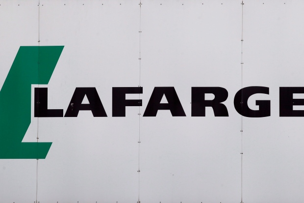 A logo of Lafarge, the world's largest cement maker, is pictured outside of a facility, in Paris, France, Friday Sept. 8, 2017. Construction materials giant Lafarge Canada says it fired an employee after a discriminatory and hateful act took place at a Montreal work site. THE CANADIAN PRESS/AP/Francois Mori