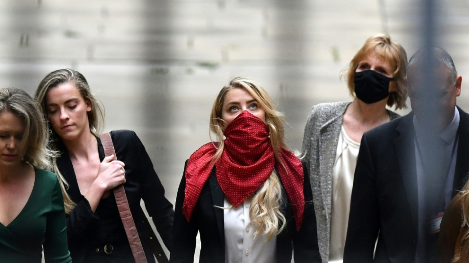 Depp's defence is trying to portray Amber Heard, pictured Thursday at the High Court, as a manipulative and scheming publicity seeker. (AFP)