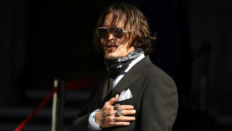 Johnny Depp said the headline in The Sun tabloid altered his Hollywood image and endangered his career. (AFP)