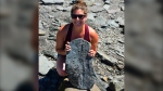 Erin Levy poses with the 310-million-year-old fossil she found in Joggins, N.S. (Submitted: Erin Levy)