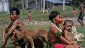 Indigenous Yanomami ethnic group members, seen waiting for COVID-19 tests at the 4th Special Frontier Platoon in Alto Alegre, Roraima state, Brazil, worry that going into cities for medical treatment will mean cutting them off from their culture.  (AFP)