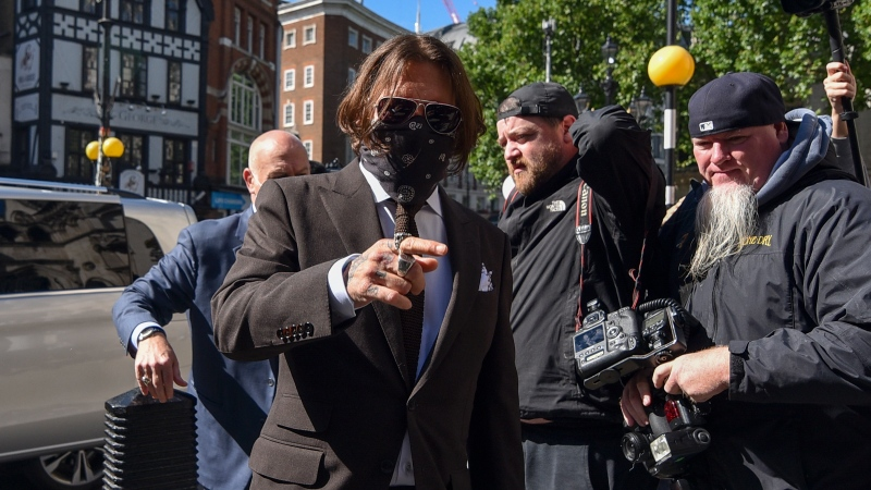 Johnny Depp arrives at the High Court in London, Friday July 10, 2020. Depp is back in the witness box at the trial of his libel suit against a tabloid newspaper that called him a 'wife-beater' in an April 2018 article that said he'd physically abused ex-wife Amber Heard. Depp strongly denies the allegations.(AP Photo/Alberto Pezzali)