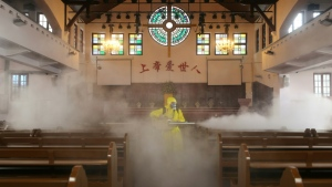 A worker disinfects a church in Wuhan, China, where the new coronavirus emerged late last year. (AFP)