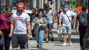Pedestrians walk on Ste. Catherine street, Thursday, June 18, 2020 in Montreal. THE CANADIAN PRESS/Ryan Remiorz