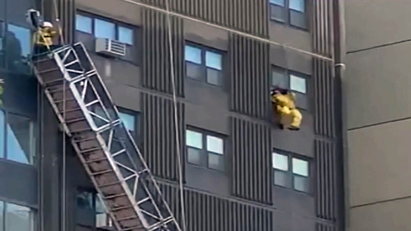Window washers rescued after scaffold collapse