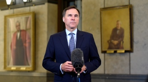 Minister of Finance Bill Morneau participates in a remote TV interview in the Foyer of the House of Commons on Parliament Hill after presenting a fiscal snapshot that is expected to reveal the economic impact of the COVID-19 pandemic, in Ottawa, on Wednesday, July 8, 2020. THE CANADIAN PRESS/Justin Tang