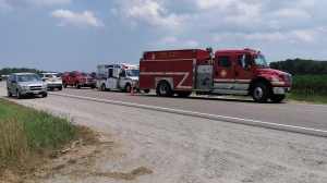 Emergency crews at the scene of a fatal collision between a motorcycle and farm tractor on Hwy 26 near Horseshoe Valley Road in Springwater Twp., Ont., on Fri., July 10, 2020. (Don Wright/CTV News)