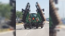 A farm tractor trailing hydro lines is seen in Listowel, Ont. on Monday, July 6, 2020. (Source: Perth County OPP)