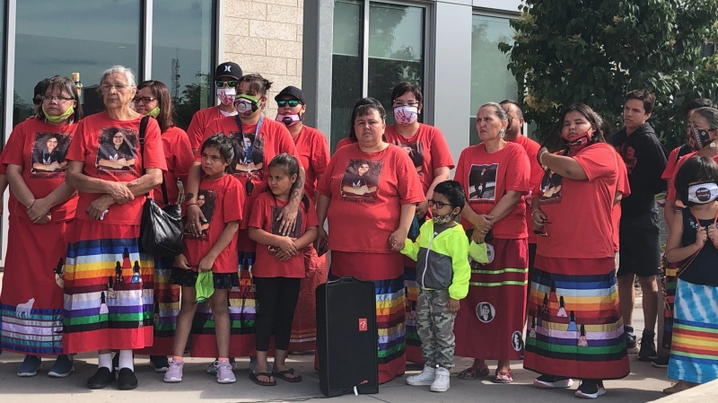 A small crowd gathers in front of police headquarters in Saskatoon to mark the second anniversary of the disappearance of Ashley Morin.