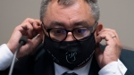 Quebec's Public Health Director Horacio Arruda adjust his mask following a news conference Friday July 10, 2020 in Gatineau. THE CANADIAN PRESS/Adrian Wyld