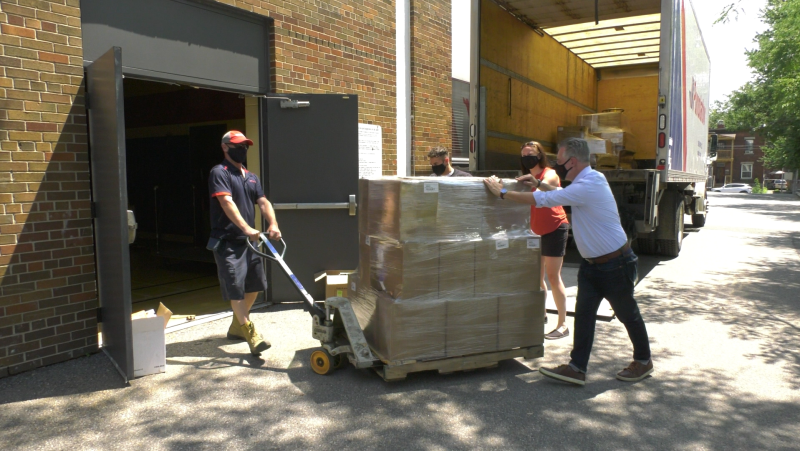 Unloading donated PPE at a downtown facility. (Shaun Vardon/CTV News Ottawa)