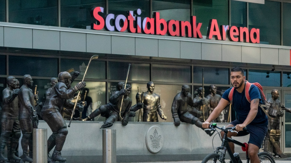 A man rides his bicycle past Scotiabank Arena in Toronto on Thursdsay July 2, 2020. THE CANADIAN PRESS/Frank Gunn