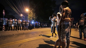A man identified as Sonny Webber (right), father of Brandon Webber, joins a standoff as protesters take to the streets of Frayser in anger against the shooting a youth identified by family members as Brandon Webber by U.S. Marshals earlier in the evening. (Jim Weber/Daily Memphian)/The Commercial Appeal via AP)