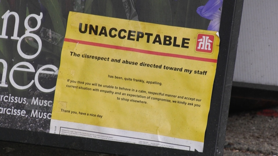 A sign posted at a Home Hardware store in Vancouver calls disrespectful and abusive behaviour towards staff during the pandemic