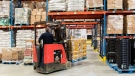 A man drives a forklift with a pallet of food products at the Moisson Montreal food bank in Montreal, Saturday, December 7, 2019. THE CANADIAN PRESS/Graham Hughes