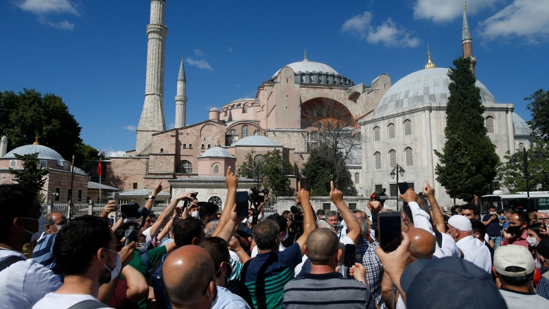 People chant slogans following Turkey's Council of State's decision, outside the Byzantine-era Hagia Sophia, one of Istanbul's main tourist attractions in the historic Sultanahmet district of Istanbul, Friday, July 10, 2020. (AP / Emrah Gurel)