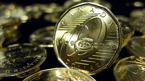 The Royal Canadian Mint unveiled a commemorative one-dollar coin marking the 100th anniversary of the Montreal Canadiens, Tuesday, March 10, 2009 in Montreal. (Paul Chiasson / THE CANADIAN PRESS)