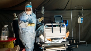 COVID-19 patients are being treated at the Tshwane District Hospital in Pretoria, South Africa, Friday July 10, 2020. (AP Photo/Jerome Delay)