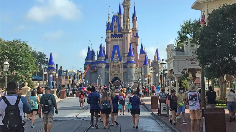 Disney annual passholders get a peek at the coronavirus-inspired changes inside the Magic Kingdom Thursday, July 9, 2020 in Lake Buena Vista, Fla. (Gabrielle Russon/Orlando Sentinel via AP)