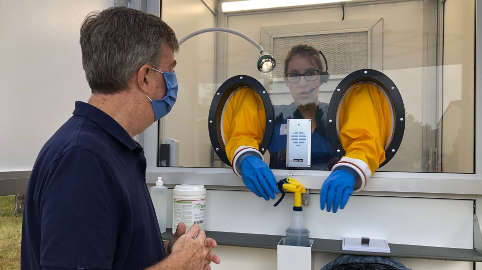 Ottawa Mayor Jim Watson visits the mobile COVID-19 testing booth at Ogilvie North Park Sat. July 11, 2020. (Dave Charbonneau / CTV News Ottawa)