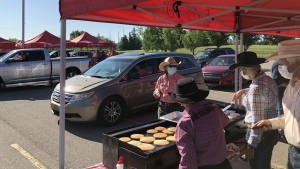Almost 200 volunteers were in place to serve up hot pancakes to visitors at the Calgary Stampede's breakfast at South Centre mall Saturday morning.