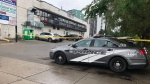 Police investigate after five people were shot when gunmen opened fire into a parking lot on Friday night. (Toronto police)