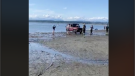 A Mercedes G-Wagon got very stuck at Crescent Beach on Friday, July 10, 2020 and needed two tow trucks to pull it out. (Facebook/Marcel Hanson)