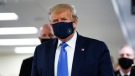 U.S. President Donald Trump wears a mask as he walks down the hallway during his visit to Walter Reed National Military Medical Center in Bethesda, Md., Saturday, July 11, 2020. (AP Photo/Patrick Semansky)