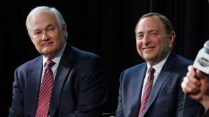 In this Jan. 24, 2015, file photo, NHL Player's Association executive director Donald Fehr, left, and NHL Commissioner Gary Bettman attend a news conference at Nationwide Arena in Columbus, Ohio. Given the gravity of the pandemic and the abrupt decision to place the NHL season on pause in March, it did not take Bettman and Fehr long to realize they were going to have to work together if play was to resume any time soon. (AP Photo/Gene J. Puskar, File)