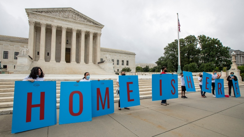 In this June 18, 2020, file photo, Deferred Action for Childhood Arrivals (DACA) students gather in front of the Supreme Court in Washington. Immigration judges say they are being muzzled by the Trump administration and the union that represents them is suing the U.S. Department of Justice. The lawsuit filed Wednesday, July 1, 2020, is the latest confrontation between the judges and the Justice Department, which oversees U.S. immigration courts. (AP Photo/Manuel Balce Ceneta, File)