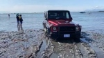Two tow trucks needed to rescue an SUV stuck on Crescent Beach on July 11, 2020.