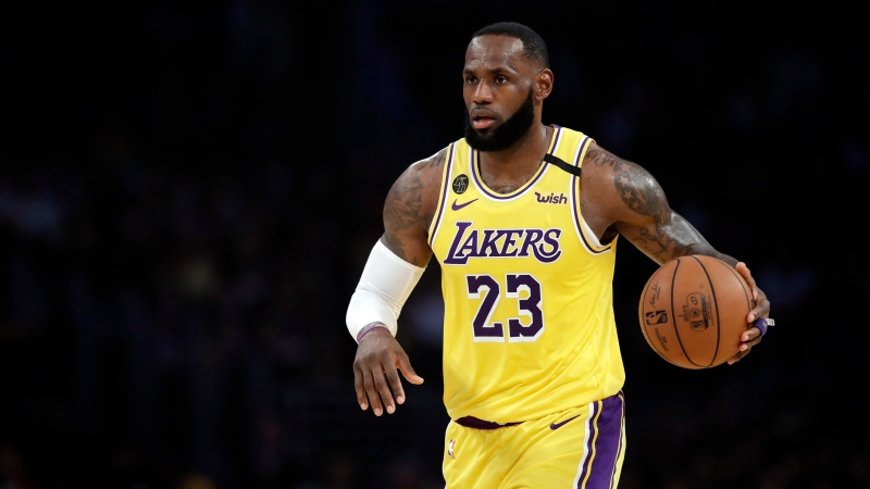 FILE - In this March 10, 2020, file photo, Los Angeles Lakers' LeBron James (23) dribbles during the first half of an NBA basketball game against the Brooklyn Nets in Los Angeles. (AP Photo/Marcio Jose Sanchez, File)